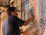 Painters restoring the interior walls of the Sher Dor (Lion) Medressa,