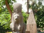 Sekhmet Sculpture with Obelisk in the background