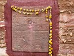 Hindu script with a Marigold wreath found at the Mehrangarh Fort wall