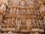 Two rows of sculptures including divine figures, couples and erotic scenes at Lakshmana Temple
