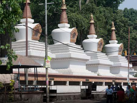 Smaller stupas at the base of the hill leading up to the temple