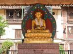Gold Buddha statue sitting in the courtyard