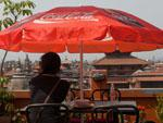 Sonya enjoying a cold drink and the view of Durbar Square